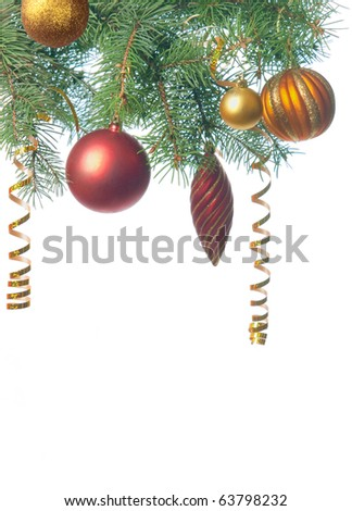Pine branches and christmas toys isolated on white background