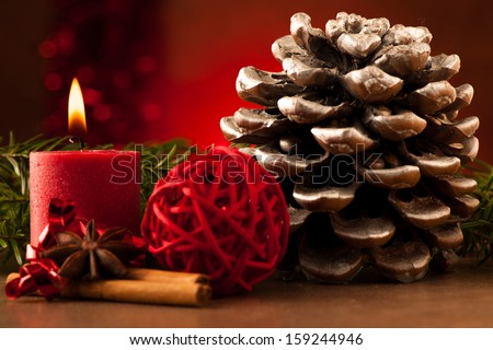 Pine cone and candle cristmas decoration - stock photo