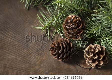 Pine cones on a wooden background - stock photo