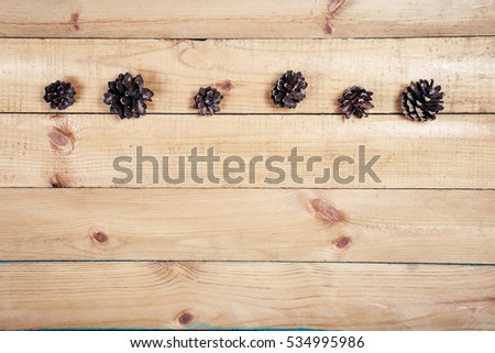Pine cones on old wooden background with copy space. Top wiev