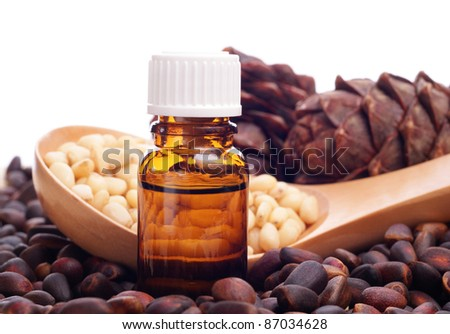 pine nuts  and bottle of essential oil - stock photo