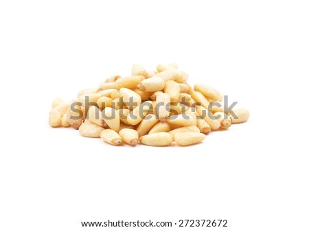 Pine nuts on white - stock photo