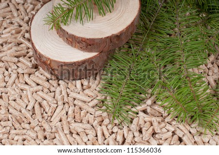 Pine Pellets- selective focus on the slices - stock photo