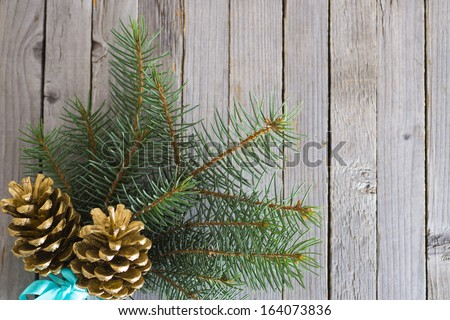 pine twig christmas decoration on rustic wood table background