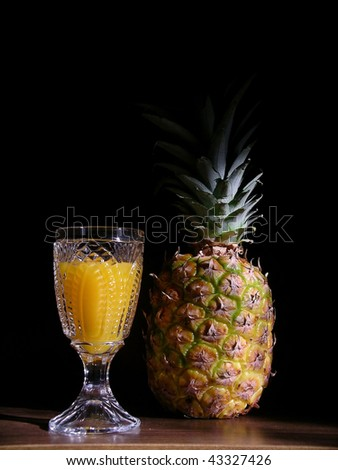 Pineapple and juice. - stock photo