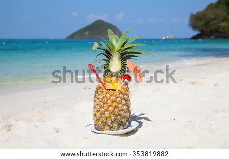 Pineapple cocktail on the white sandy beach - stock photo