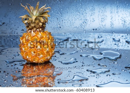 Pineapple fruit and droplets of water. - stock photo