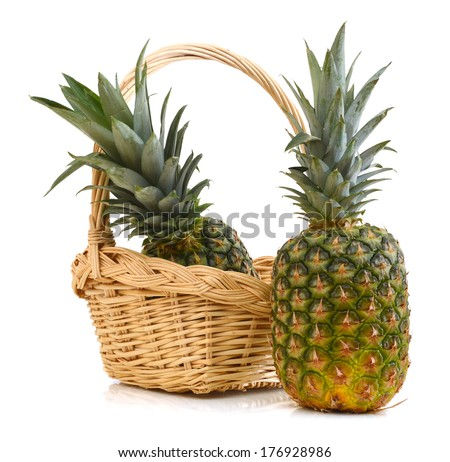 pineapple in basket on white  - stock photo