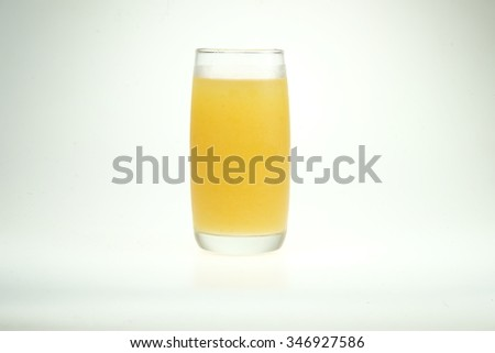 Pineapple juice in a glass. Isolated on white background - stock photo