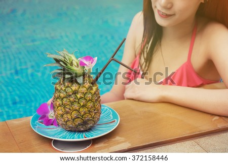 Pineapple juice Tropical drinks at the swimming pool,Vintage effect. - stock photo