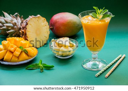 Pineapple mango smoothie and ingredients.