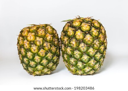 pineapple on white table isolated - stock photo