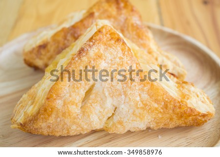 Pineapple pie in wooden plate