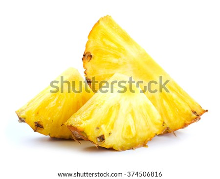 Pineapple slices on white background - stock photo