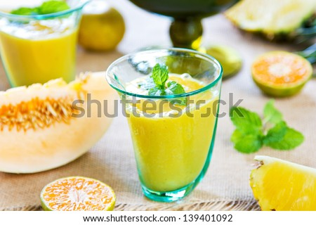 Pineapple with Orange and Cantaloupe smoothie - stock photo