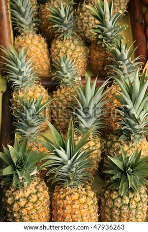 pineapples for sale at a roadside stand on maui hawaii - stock photo