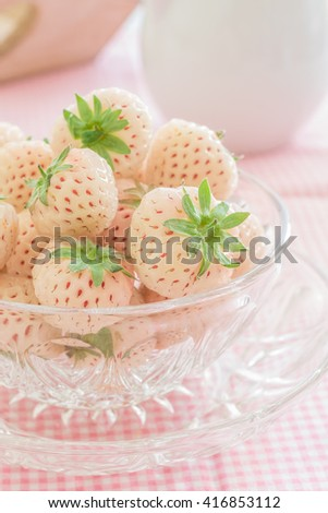 Pineberries or Hula Berries a hybrid strawberry with a pineapple flavor white flesh and red seeds - stock photo