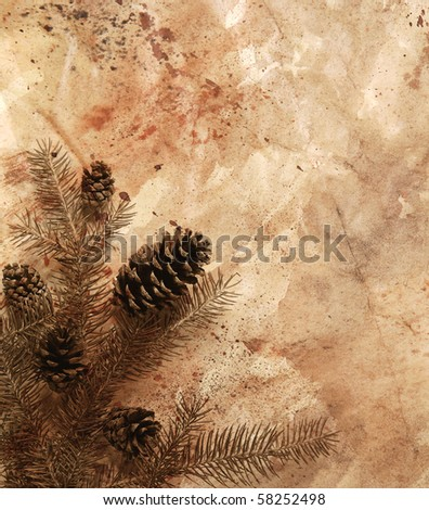 pinecones and pine branch layered with painted paper texture