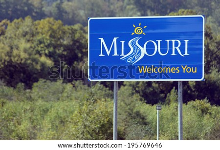 PINEVILLE, MO - OCTOBER 4: A welcome sign at the Missouri state line located in Pineville, Missouri on October 4, 2012. Missouri is a Midwestern U.S. state and the 24th state admitted to the union.  - stock photo