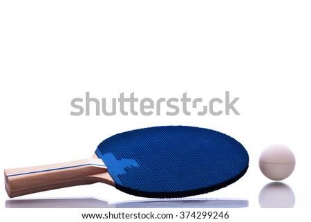 Ping pong racket and ball. - stock photo