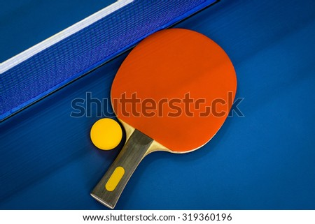 Ping-pong rackets and ball, ping pong tables blue. Table tennis. To exercise and stay healthy. - stock photo