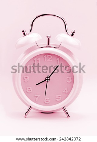 Pink alarm clock - stock photo