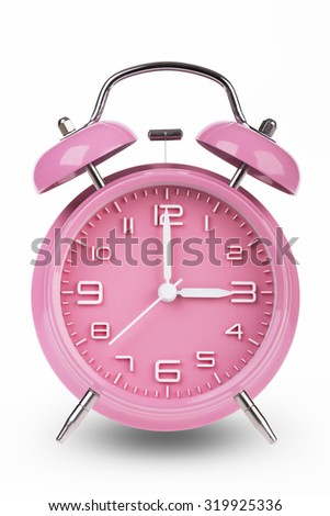 Pink alarm clock with the hands at 3 am or pm isolated on a white background. - stock photo