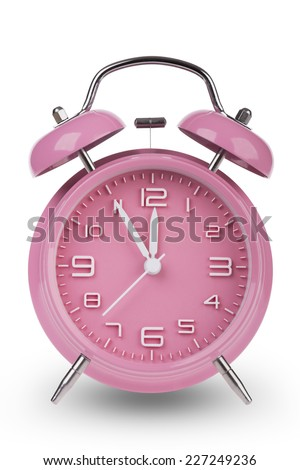 Pink alarm clock with the hands at 5 minutes till 12. Illustrating Time is Running Out isolated on a white background - stock photo