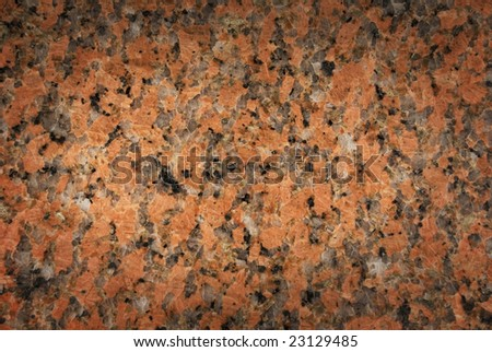 Pink and black granite texture fading to dark edges - stock photo