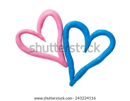 Pink and blue plasticine heart. Isolated on white background