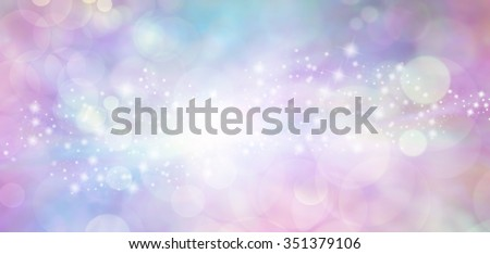 Pink and blue starry glitter feminine toned bokeh background banner - Wide pink and blue  sparkling glittery star speckled background with a whoosh of stars moving through the middle - stock photo