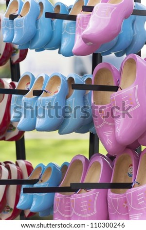 Pink and blue wooden clogs - stock photo
