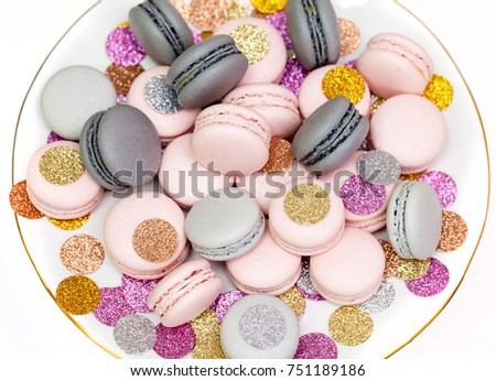 Pink and Grey macarons with sparkling decoration. White background. Holiday dessert.