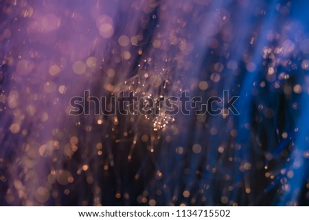Pink and purple bokeh background with  many tiny lights.