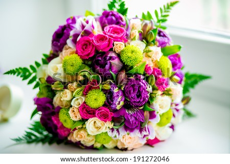 Pink and purple bridal bouquet - stock photo