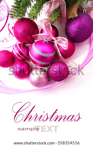 Pink and purple Christmas baubles with a Christmas tree and ribbon isolated on white - stock photo