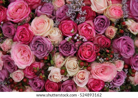 Pink purple roses wedding flower arrangement stock photo edit now pink and purple roses in a wedding flower arrangement mightylinksfo