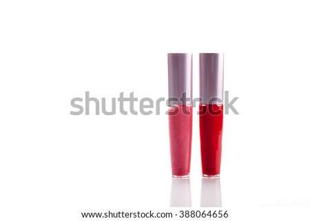Pink and red lip gloss isolated on white. - stock photo