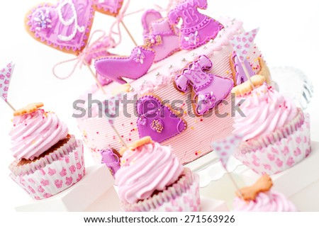 pink and violet girl's birthday cake on the plate