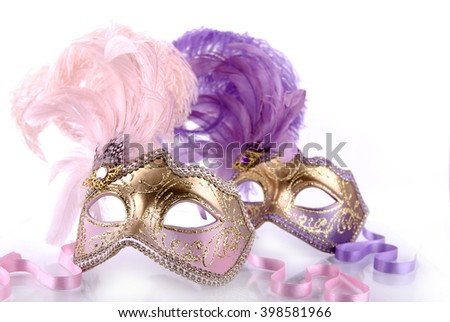 Pink and  violet venecian carnival masks on a white background. - stock photo