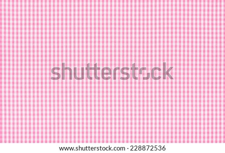 Pink and white checkered fabric - stock photo