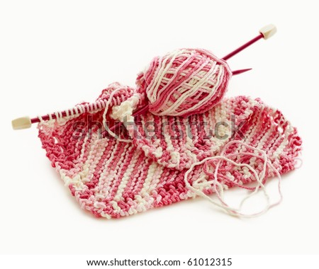 Pink and white hand knitted project from worsted weight cotton. - stock photo