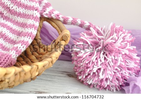 Pink and white hat with big pom pom - stock photo