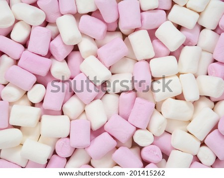 Pink and white mini marshmallows, abstract background texture - stock photo