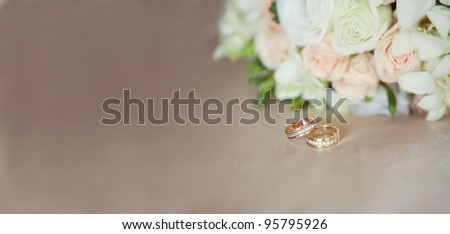 pink and white wedding bouquet and wedding rings - stock photo