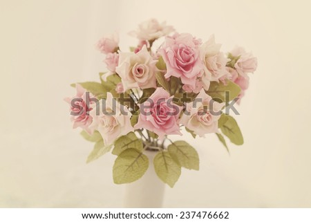 pink artificial roses bouquet in soft pastel color - stock photo