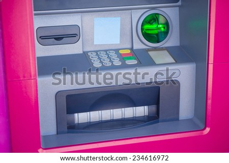 Pink ATM with keyboard and money dispenser - stock photo
