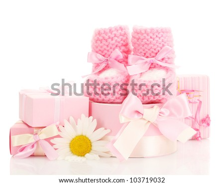 pink baby boots, gifts and flower isolated on white