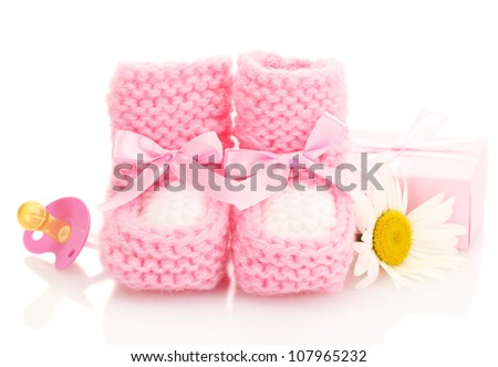 pink baby boots, pacifier, gift and flower isolated on white