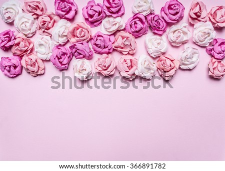 pink background with colorful paper roses decorations for Valentine's Day border ,place for text   top view close up - stock photo